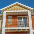 Square Close up of the balcony of a home with a combination of white and otange wall Royalty Free Stock Photo