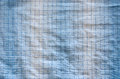 Square dotted fabric overflowing overlaying blue white color background Royalty Free Stock Photos