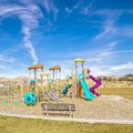 Square frame Colorful slides on an urban kids playground Royalty Free Stock Photo