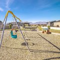Square A-frame kids swings in an urban playground Royalty Free Stock Photo