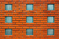 Square glass block windows in a red brick wall Royalty Free Stock Photo