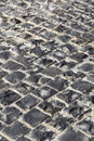 Square granite stones on the pavement Stock Photos