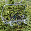 Square Lift accessed mountain biking with bikes on chairlifts in Park City in summer Royalty Free Stock Photo