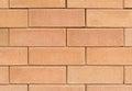 Square orange brick wall background of closeup Stock Image
