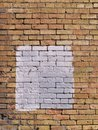 Square patch of white paint on brick wall Royalty Free Stock Photography