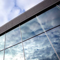Clouds reflected in windows of office building Royalty Free Stock Photo