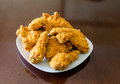 Square Plate of Fried Chicken on Wood Table Royalty Free Stock Photo