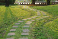 Square stones curved path stone walkway in the garden Royalty Free Stock Photography