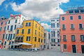 Square under clouds venetian with colorful building a cloudy sky Royalty Free Stock Photo