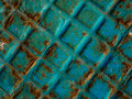 Squared rust texture on blue background Royalty Free Stock Photo