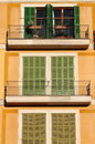 Squared windows with balcony closed shutters and balconies Royalty Free Stock Photography