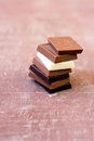 Squares of assorted chocolate dark milk white and with nuts Stock Image