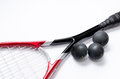 Squash closeup of racket isolated on white with three black balls Royalty Free Stock Images