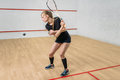 Squash game training, female player with racket Royalty Free Stock Photo