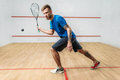 Squash game training, male player with racket Royalty Free Stock Photo