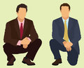 Squatting businessmen two business men or kneeling down Stock Image