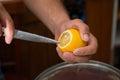 Squeeze lemon juice on hand close up Stock Photos