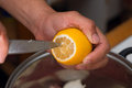 Squeeze lemon juice on hand close up Royalty Free Stock Photo