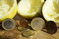 Squeezed economies concept of crisis and through the image of lemon and some coins Stock Photos