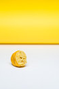 Squeezed lemon lying on a white and yellow background Royalty Free Stock Photography