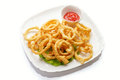Squid rings in batter on a white Royalty Free Stock Photo