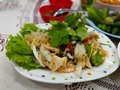 Squid salad and fresh vegetables on a plate on the table. Royalty Free Stock Photo