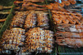 Squids and prawns grilled display Royalty Free Stock Photography
