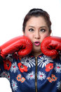 Squint eyed crazy woman in boxing gloves isolated on white Stock Photo