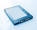 Ssd disk drive in blue technological background tilt shift lens used to accent the center of the hdd and to emphasize the Royalty Free Stock Photos