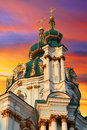 St andrew church very famous touristic place in kiev of over colorful sunset sky Stock Photo