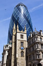 St andrew undershaft church and the gherkin in london historic with mary axe towering above it city of Stock Photography