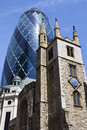 St andrew undershaft church and the gherkin in london historic with mary axe towering above it city of Royalty Free Stock Photos