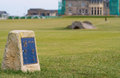 St andrews golf marker on the th tee of course looking towards the swilken bridge and the club housr Stock Photo