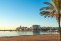 St Antoni de Portmany,  Ibiza,  Balearic Islands, Spain.  Calm water along boardwalk & beach in warm, late day sunlight. Royalty Free Stock Photo