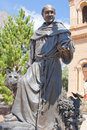 St francis statue a of of assisi in front of his cathedral named for him in santa fe nm Royalty Free Stock Images