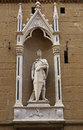 St george statue beautiful of saint stands in a niche in the ancient wall in florence italy Stock Images