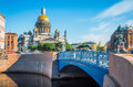 St. Isaac`s Cathedral in the morning in the summer, and a view of the river and blue bridge. Royalty Free Stock Photo