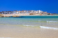 St ives cornwall england uk on porthminster beach with the harbour and town in the background Royalty Free Stock Images