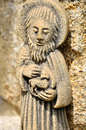 St john baptist statue small granit of holding a lamb and announcing the message of the risen christ Royalty Free Stock Image