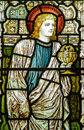 St john the evangelist stained glass window victorian showing apostle holding a chalice containing a winged serpent Stock Photo