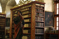 St john statue in strahov library a late gothic wooden of the evangelist at strahovs monastery the czech republic hes holding a Stock Images