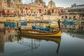 St.Julian`s, Malta - Traditional colorful Luzzu fishing boats Royalty Free Stock Photo