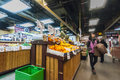St lawrence market downtown toronto canada asian shopper walking pass by fresh fruits at Royalty Free Stock Photo