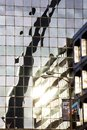 St. Louis, Missouri, United States-circa 2014-Gateway Arch reflected in glass high-rise office building downtown Royalty Free Stock Photo
