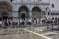 St mark s square floods slight flooding at in venice italy when this happens due to tides rising they use elevated walkways for Royalty Free Stock Photo