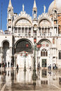 St marks in venice italy during the acqua alta reflections of people are caught or high tide that happens periodically Stock Images