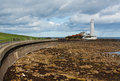 St marys lighthouse on the north east coast flood defences and promenade to near tynemouth of england Stock Photography