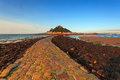 St michaels mount cobbled causeway in cornwall england uk looking towards the castle with low tide revealing the at sunrise during Stock Photo