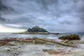 St michaels mount cornwall england on a dull overcast day uk cloudscape medieval castle and church in hdr Royalty Free Stock Images