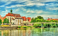 St. Oswald Church with Eiserner Steg bridge across the Danube River in Regensburg, Germany Royalty Free Stock Photo
